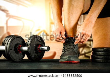 Gym interior and woman hand  #1488852500