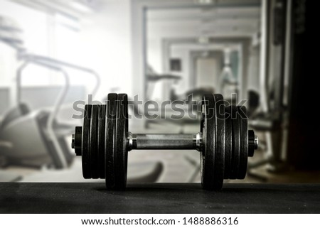 Black and silver dumbbells and gym interior  #1488886316