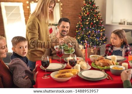 Happy family having Christmas dinner at home #1488953957