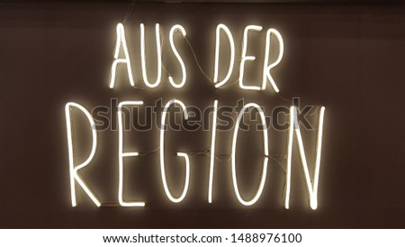 Aus der Region neon letters writing Royalty-Free Stock Photo #1488976100