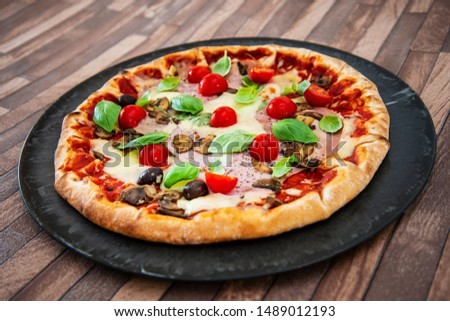 pizza cooked with standard cooked ham and mushrooms #1489012193