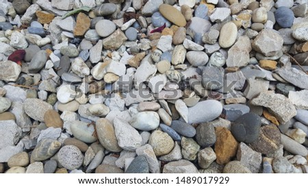 light colorful pebble stones texture Royalty-Free Stock Photo #1489017929