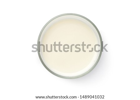Top view of fresh milk in glass isolated on white background with clipping path. Royalty-Free Stock Photo #1489041032