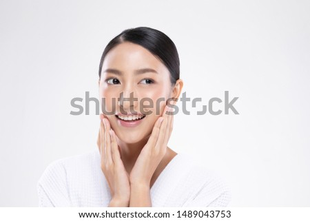 Beautiful Asian woman touching soft cheek smile with clean and fresh skin Happiness and cheerful with positive emotional,isolated on white background,Beauty and Cosmetics Concept #1489043753
