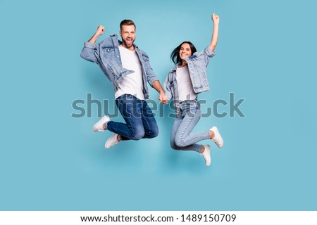 Photo of rejoicing overjoyed nice charming couple wearing jeans denim jackets enjoying their free time in summer while isolated with blue background #1489150709