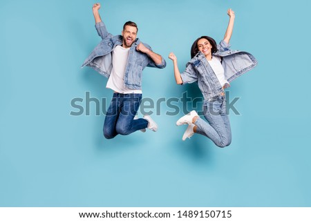 Photo of overjoyed joyful cute nice couple of spouses jumping flying in air happily while isolated with blue background #1489150715