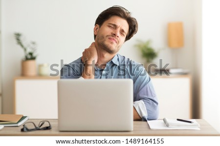 Neck Pain. Man Having Bad Neckache Working On Laptop At Workplace. #1489164155