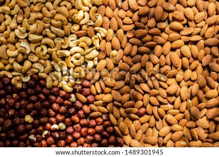 Nuts baked - almond, cashew, hazelnut in sun light, top view #1489301945