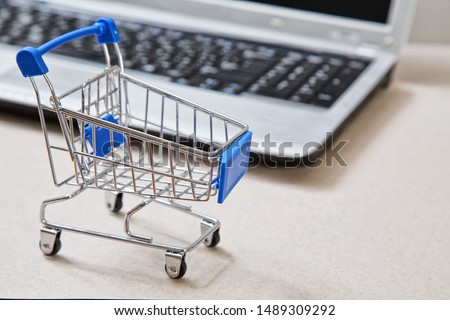 online shopping and e-commerce. Basket and laptop #1489309292