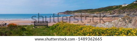 A panoramic view of the beautiful Barricane Beach in Woolacombe in North Devon, UK.  Royalty-Free Stock Photo #1489362665