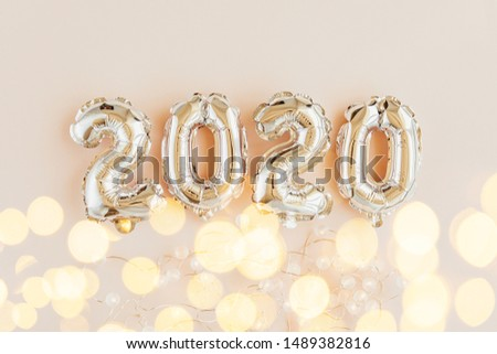 Foil balloons in the form of numbers 2020. New year celebration. Gold and silver Air Balloons. Holiday party decoration.  #1489382816