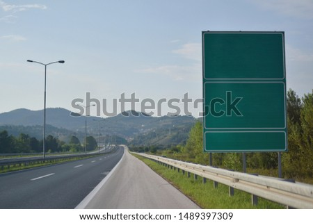 Highway and  road signs at cloudy day.