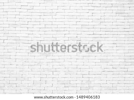 White brick wall texture background in rural room, pattern of gray aged weathered blocks of stonework technology color horizontal architecture for interior background, wallpaper, web design template