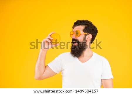 Best orange snack. Happy guy taking snack break on yellow background. Hipster looking at healthy organic snack. Snack that gives you energy, copy space. #1489504157