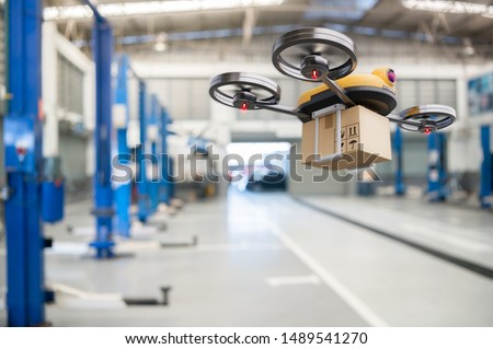Spare part delivery drone at garage storage in leading automotive car service center for delivering mechanical shipping component part assembling to customer. Modern innovative technology and gadget #1489541270