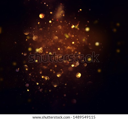 background of abstract glitter lights. gold and black. de focused #1489549115
