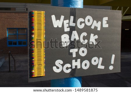 """Welcome Back To School"" sign at the entrance to an elementary school."