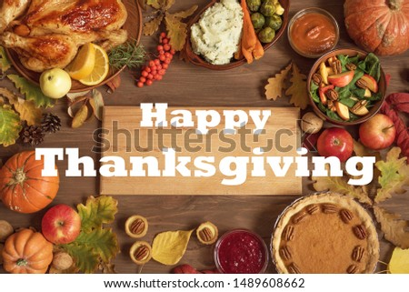 Autumn festive Thanksgiving dinner background with Turkey and traditional sides dishes around Wooden Board, copy space for text, menu design, seasonal food concept. #1489608662