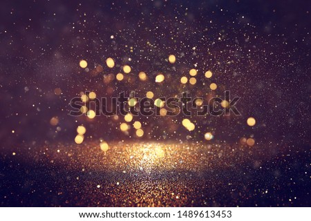 background of abstract glitter lights. gold and black. de focused #1489613453