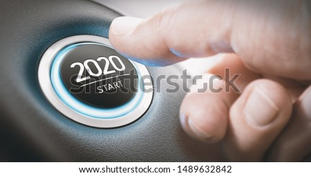 Finger about to press a car ignition button with the text 2020 start. Year two thousand and twenty concept. #1489632842