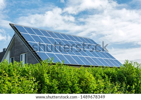 House with solar panels on the roof on a sunny day  #1489678349