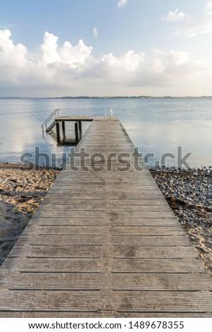 Wooden pier leading towards the ocean #1489678355