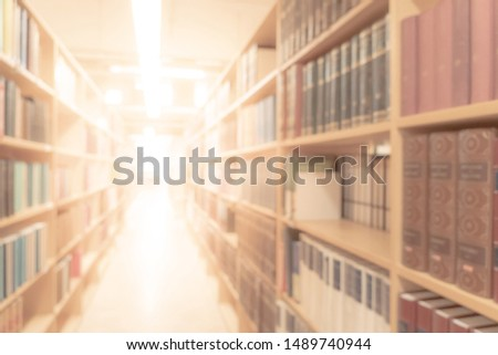 Abstract blurred public library interior space. blurry room with bookshelves by defocused effect. use for background or backdrop in business or education concepts #1489740944