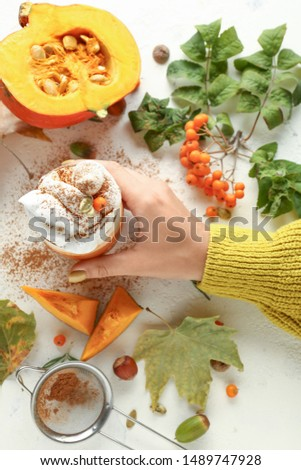 Female hand with glass of tasty pumpkin coffee on white background #1489747928