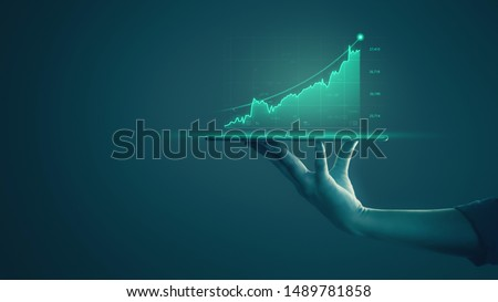 Business man holding tablet and showing holographic graphs and stock market statistics gain profits. Concept of growth planning and business strategy. Display of good economy form digital screen. #1489781858
