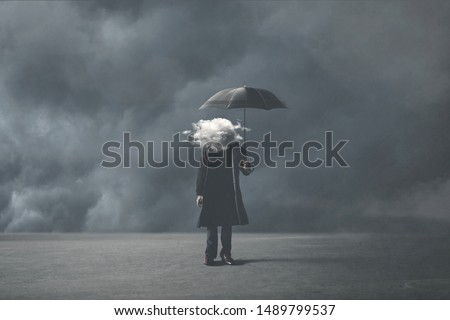 sad surreal man with cloud on his head Royalty-Free Stock Photo #1489799537