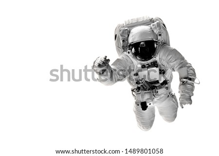 astronaut flies over the white backgrounds. Elements of this image furnished by NASA #1489801058