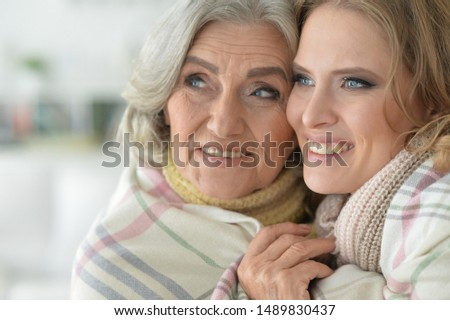 Close up portrait of enior woman with daughter #1489830437
