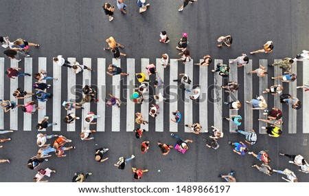 Aerial. People crowd on pedestrian crosswalk. Top view from drone.  #1489866197