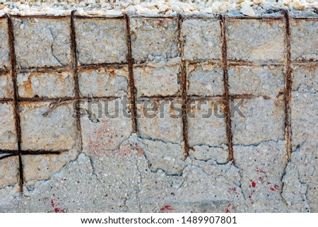 View of the poor concrete cover and corrosion of reinforcement bars. Concrete can be damaged by physical damage and chemical damage (from carbonatation, chlorides, sulfates and non-distilled water). #1489907801