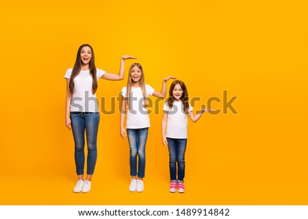 Full size photo of three sister ladies not believe such quick growing up wear casual outfit isolated yellow background Royalty-Free Stock Photo #1489914842