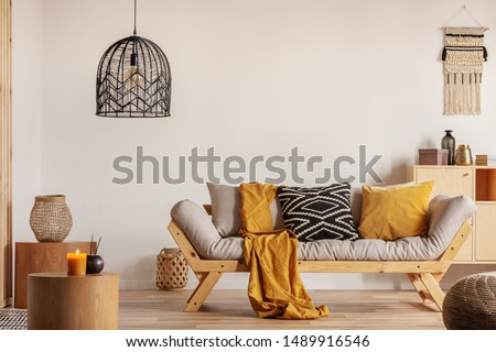 Chic black chandelier above couch in contemporary living room #1489916546