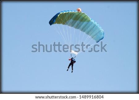 Adrenalin experience during a parachute jump #1489916804
