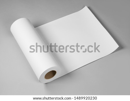 Blank white paper rolls isolated on gray background. Mockup paper for magazines, catalogs or newspapers isolated on gray backdrop, Printing house theme or wrapping paper for presents Royalty-Free Stock Photo #1489920230
