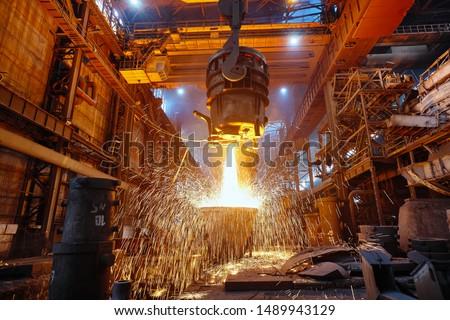 Metallurgy. Casting ingot. Electric arc furnace shop. #1489943129