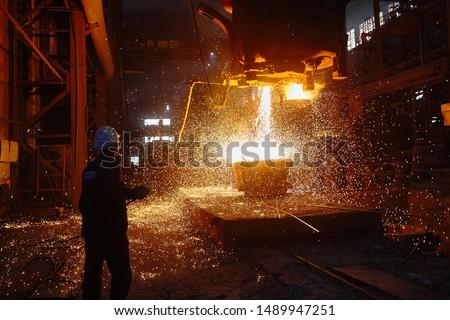 Steelmaker at ingot casting. Electric arc furnace shop EAF. Metallurgy. #1489947251