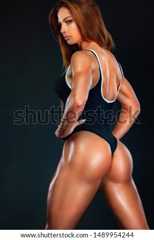 Beautiful fitness woman athlete and bodybuilder with perfect body wearing sport clothes for the gym training. Individual sports. Sports recreation. #1489954244