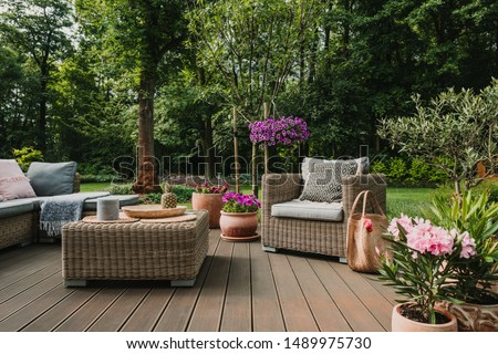 Elegant garden furniture on terrace of suburban home #1489975730