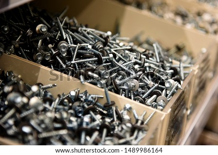 a lot of nails and screws in boxes. tools for repair. men's business. building. hobby . Selective focus Royalty-Free Stock Photo #1489986164