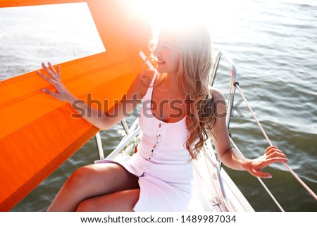 Beautiful tanned woman resting on a yacht in the sea. Relax and comfort concept. #1489987034