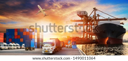 Container truck in ship port for business Logistics and transportation of Container Cargo ship and Cargo plane with working crane bridge in shipyard at sunrise, logistic import export and transport  #1490011064