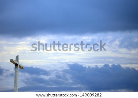 Christian background with cross sun shining through and sky