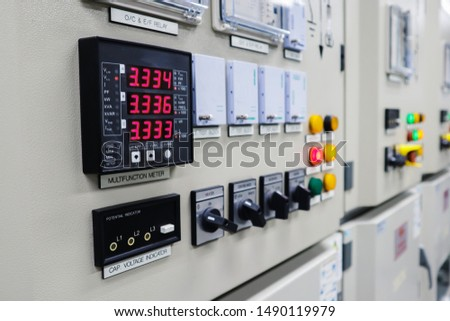 Selective focus the power meter on Electrical switch gear high Voltage motor control center cabinet in power plant,Breaker module,Electrical selector switch,button switch #1490119979