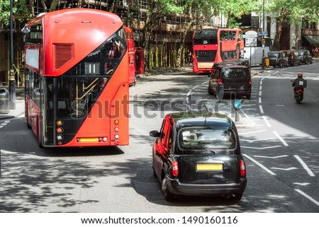London road traffic, double decker buses and traditional taxi, traditional vehicles of London city . #1490160116