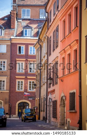 Warsaw, Poland - July 2, 2019: Streets of the old city. Polish ancient architecture. European city - tourist route attractions. Attraction - colorful houses, paving stones in the streets. #1490185133