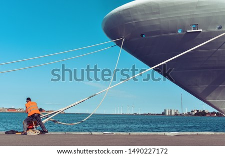 mooring of a large ship to the pier Royalty-Free Stock Photo #1490227172